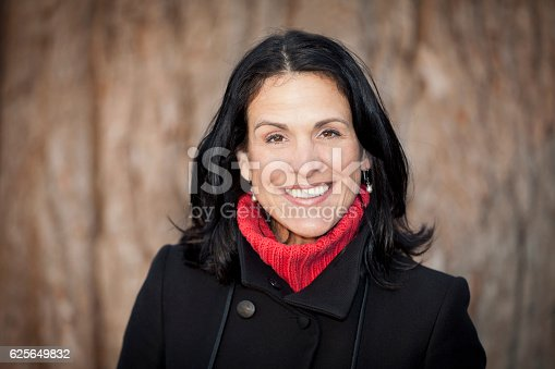 625010932istockphoto Mature Spanish Woman Smiling At The Camera. Outside. 625649832
