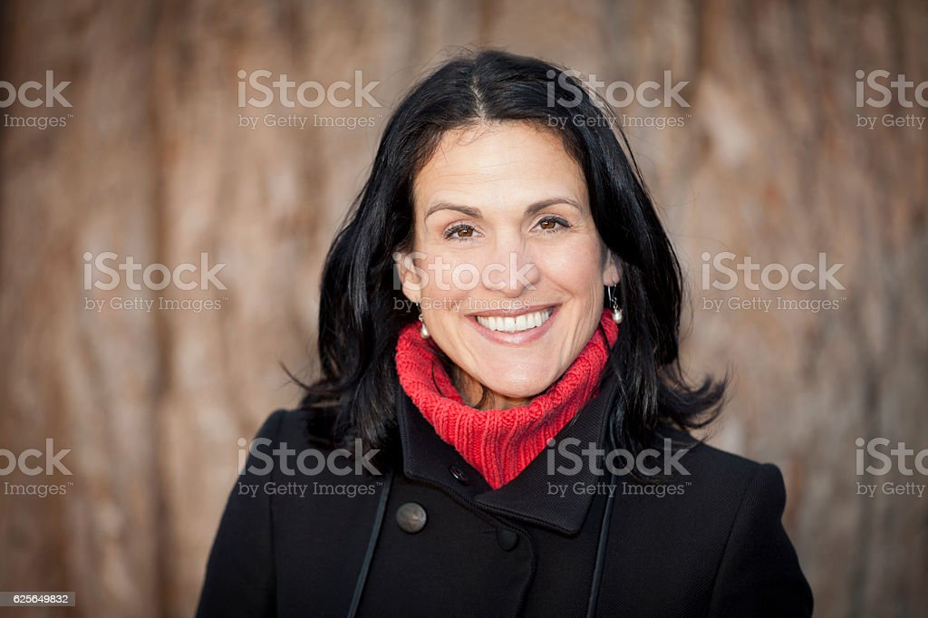 Mature Spanish Woman Smiling At The Camera. Outside. - foto de stock