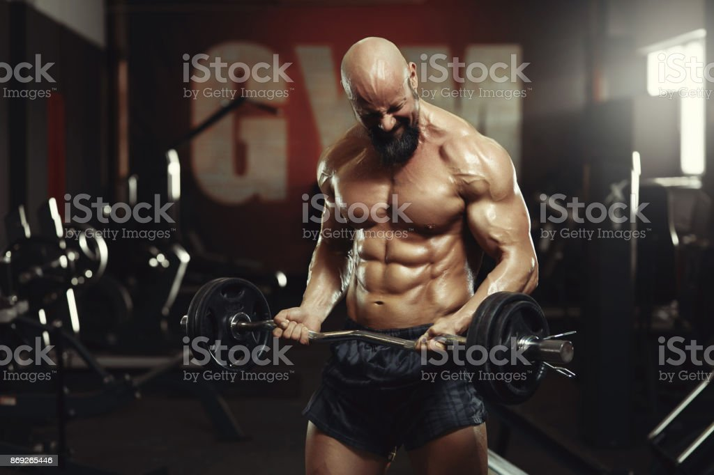 Mature sportsman exercising at the gym stock photo