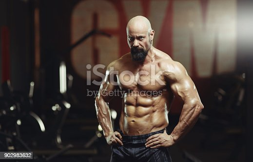 istock Mature sportsman exercising at the gym 902983632