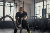 istock Mature strong man battling with rope 1149241543