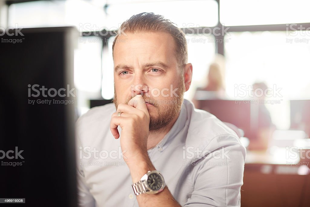 Mature Student in classroom at the computer stock photo
