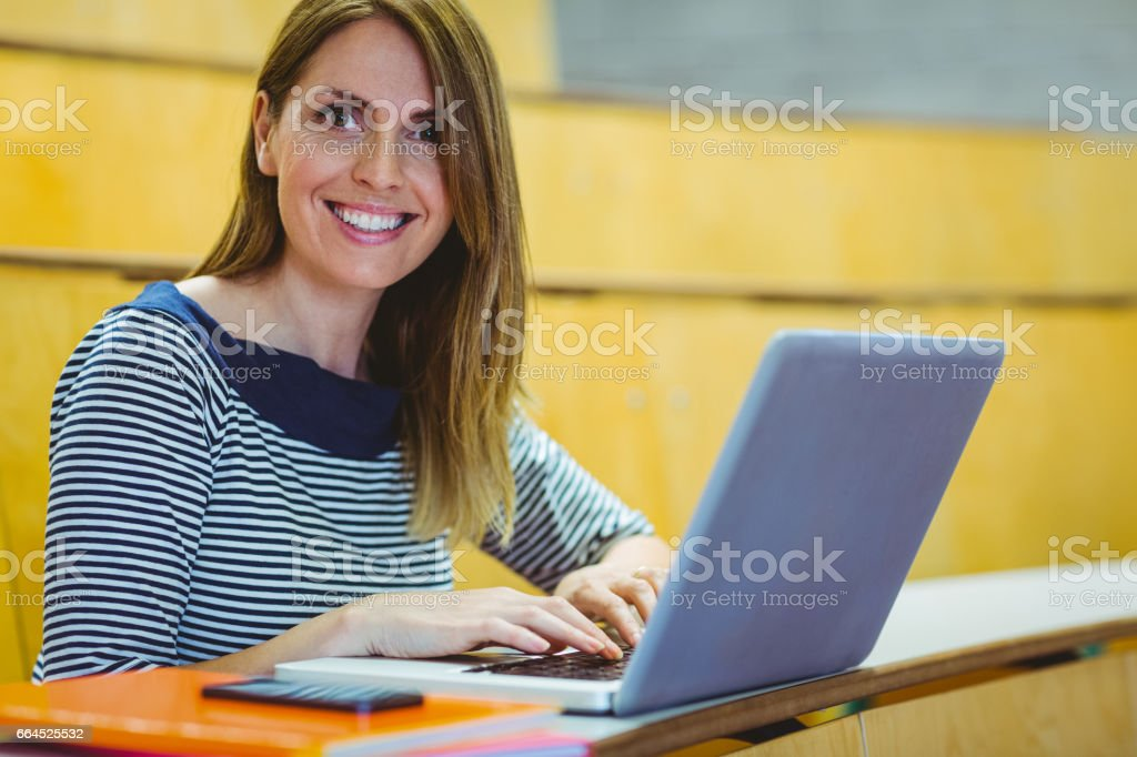 Mature student in lecture hall royalty-free stock photo