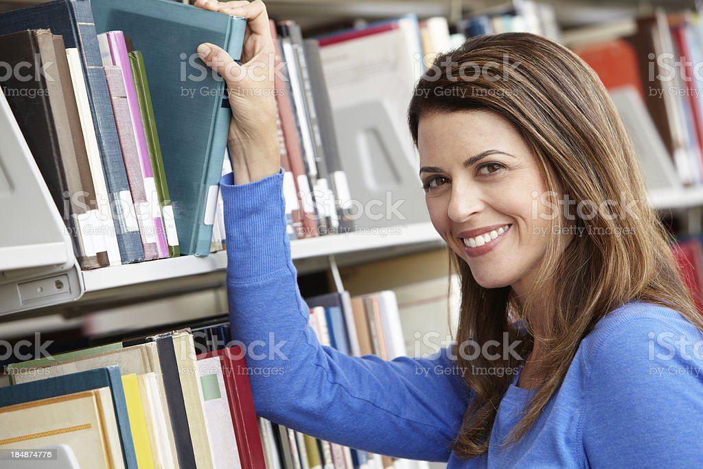Mature student in library royalty-free stock photo