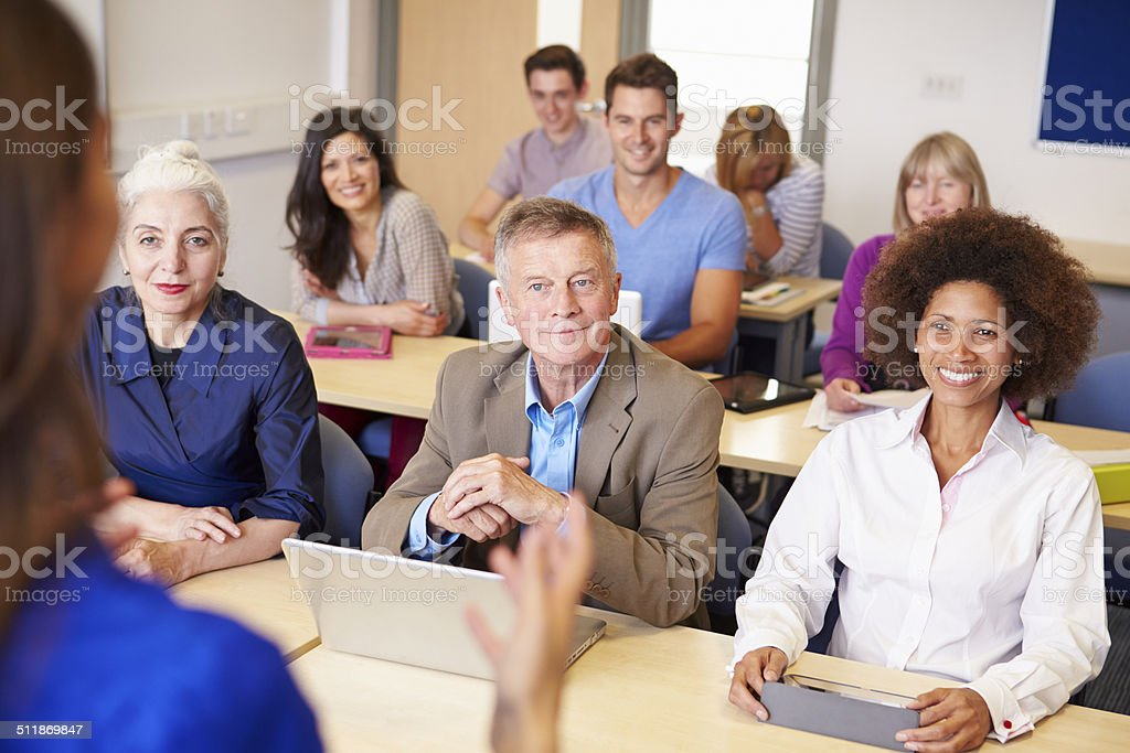 Mature Students In Further Education Class With Teacher stock photo