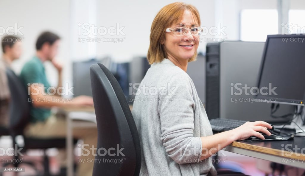 Mature students in the computer room stock photo