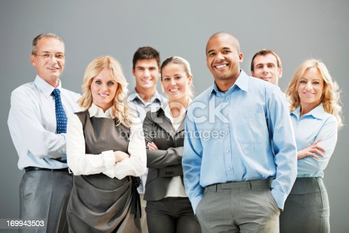 istock Mature successful business man with colleagues in office 169943503