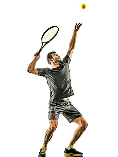 mature tennis player man serving service isolated white background stock photo