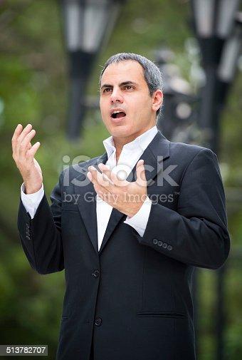 Mature tenor posing singing at the park