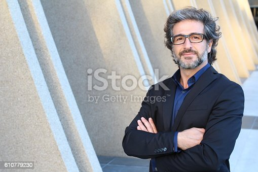 istock Mature urban business man with specs 610779230