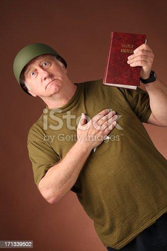 mature veteran us soldier swears allegiance  on bible