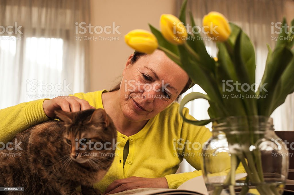 Mature woman and cat, Domestic life