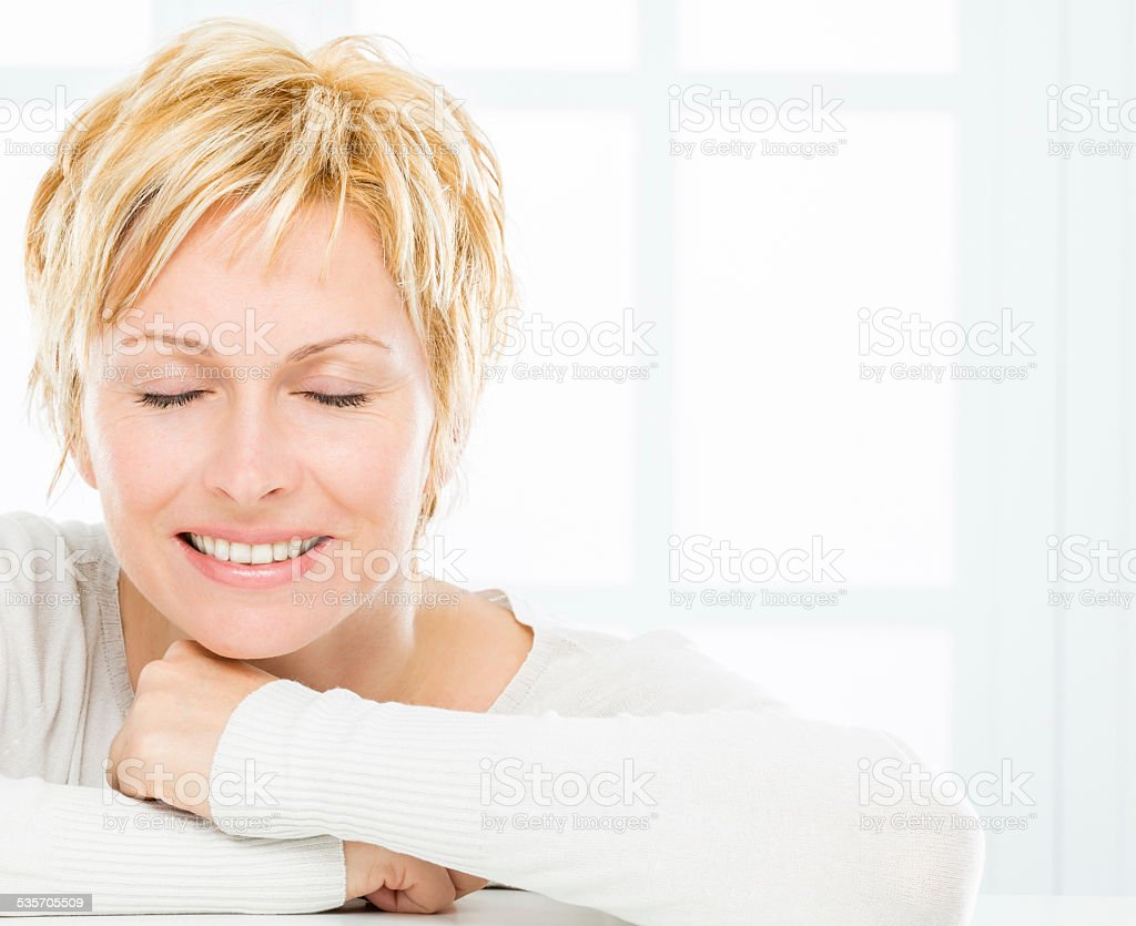 Mature woman and face care. stock photo