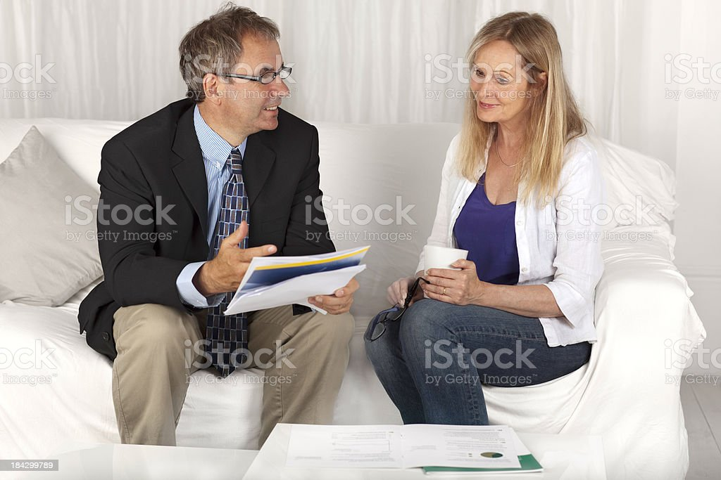Mature woman and financial advisor royalty-free stock photo
