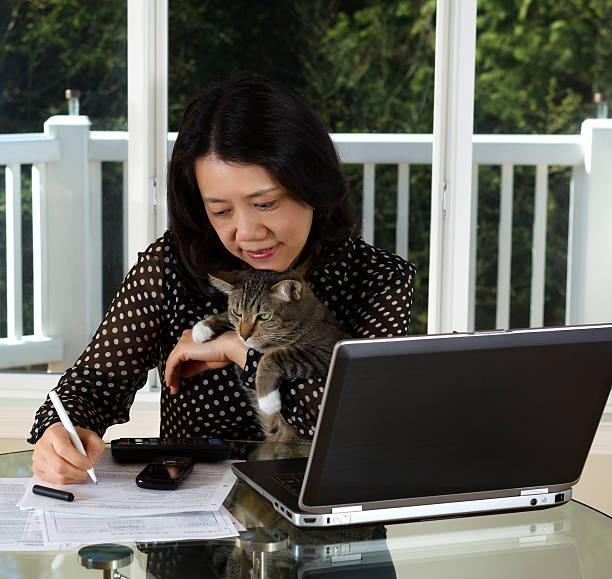 Mature woman and her pet cat working at home picture id487360883?b=1&k=6&m=487360883&s=612x612&w=0&h=ucth5ib0cp l2oaelhyqz8khjkzz5xzx3hyfgnzsjci=