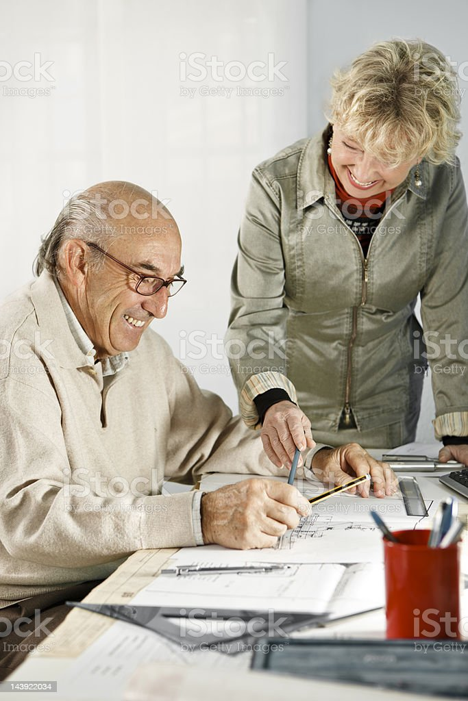 Mature Woman and Man Working at Desk royalty-free stock photo