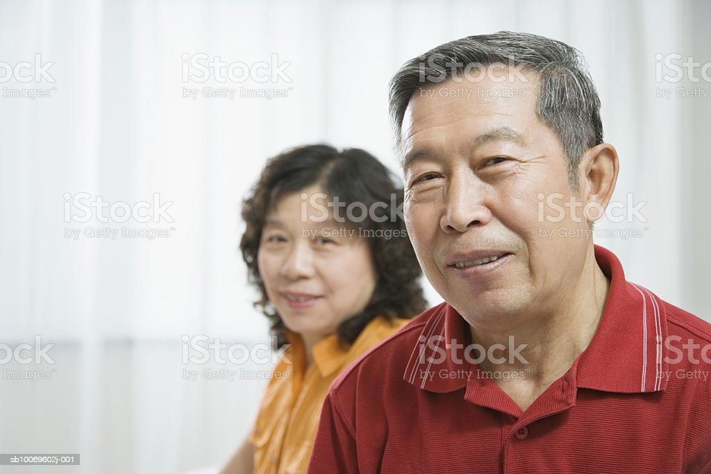 Mature woman and senior man, smiling royalty-free stock photo