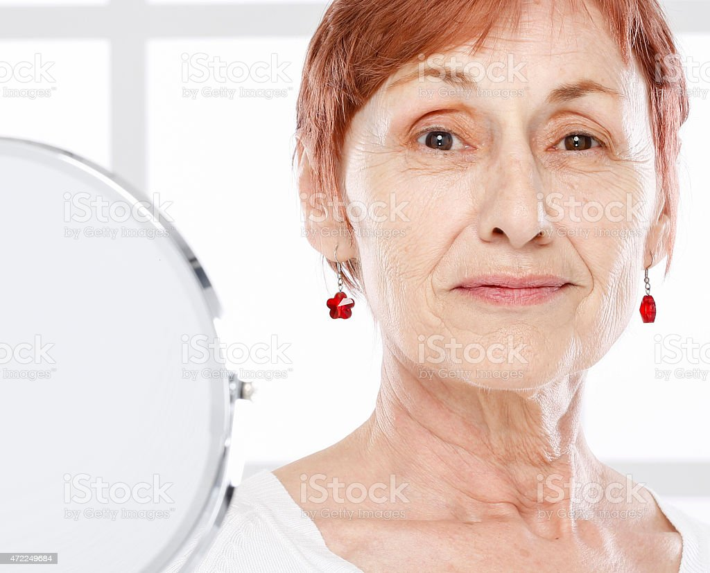 Mature woman and skin care. stock photo