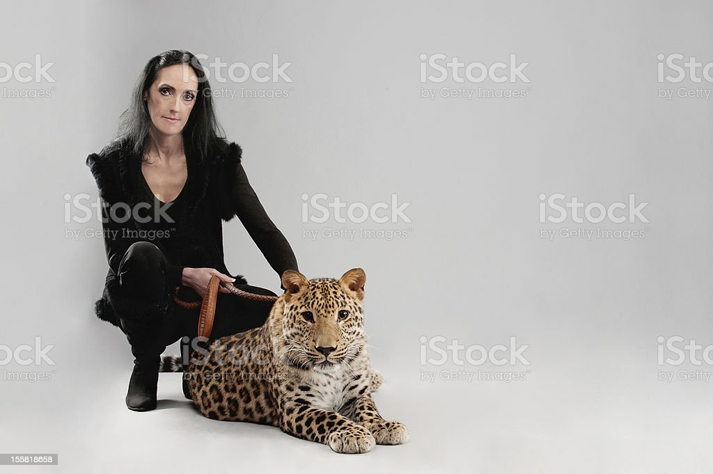 Mature woman and spotty leopard royalty-free stock photo