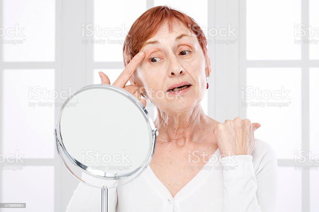Mature woman and wrinkles. stock photo