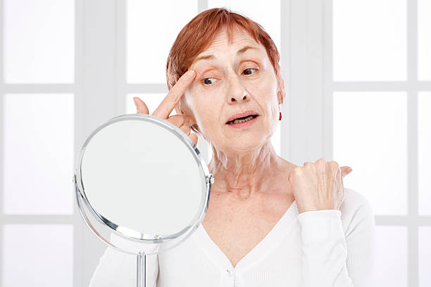 mature woman and wrinkles. - eyelid stock pictures, royalty-free photos & images