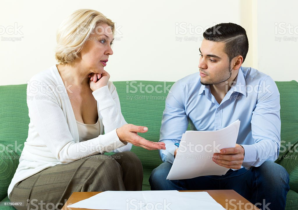 mature woman and young boyfriend stock photo