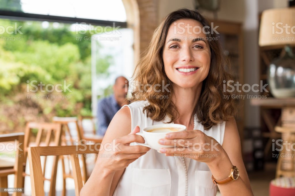 Mature woman at cafeteria stock photo