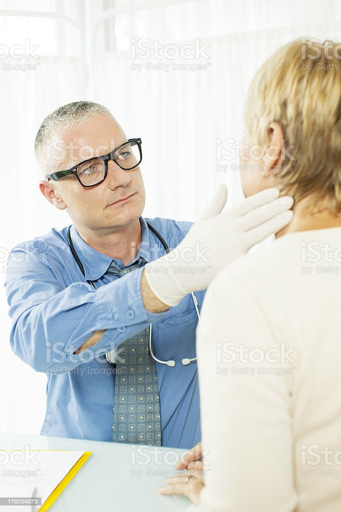Mature Woman at doctors office. stock photo