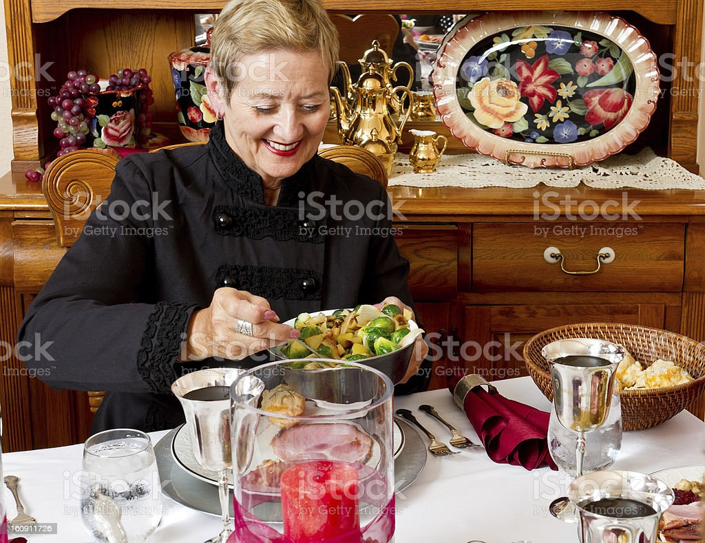 Mature Woman at Holiday Dinner royalty-free stock photo