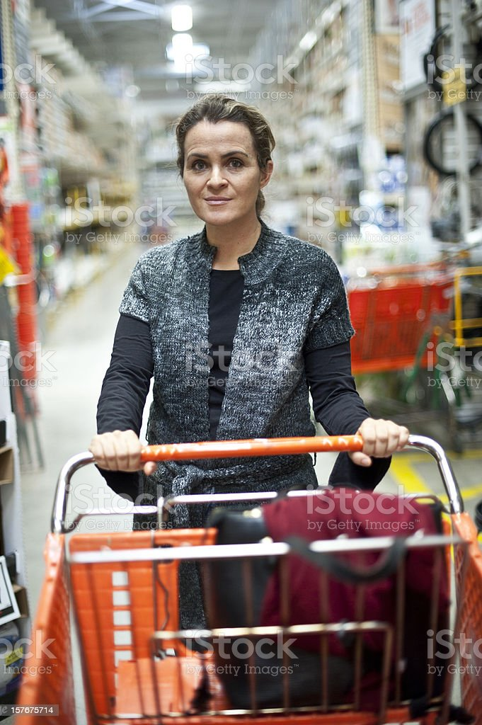 Mature woman at the Hardware Store royalty-free stock photo