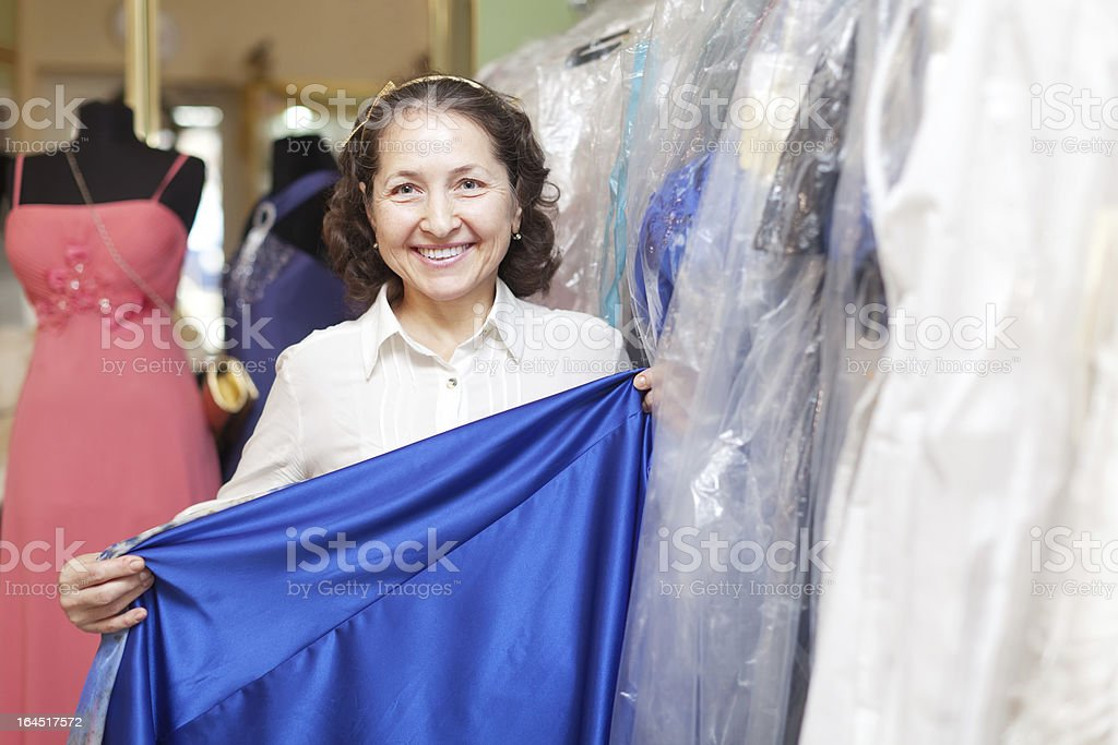 mature woman chooses dinner gown royalty-free stock photo