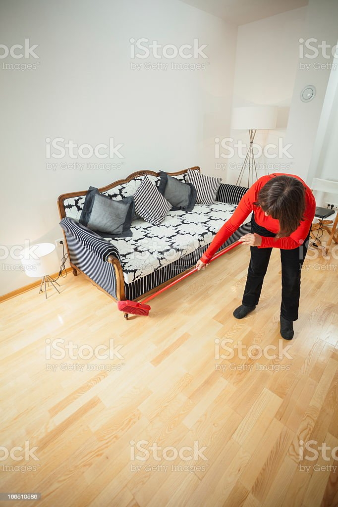 Mature woman cleaning her home royalty-free stock photo