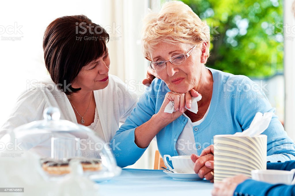 Mature woman consoling her friend royalty-free stock photo