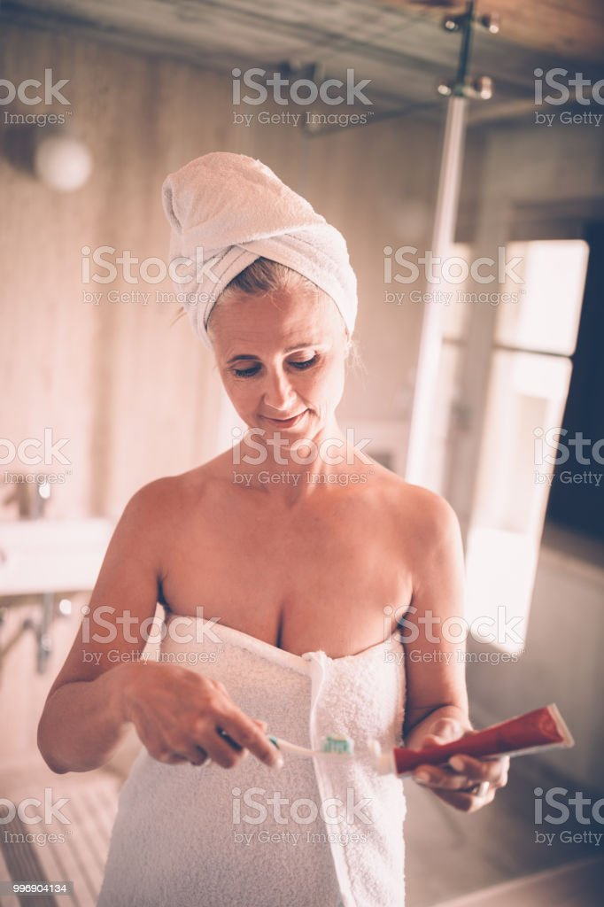 Mature women taking a shower