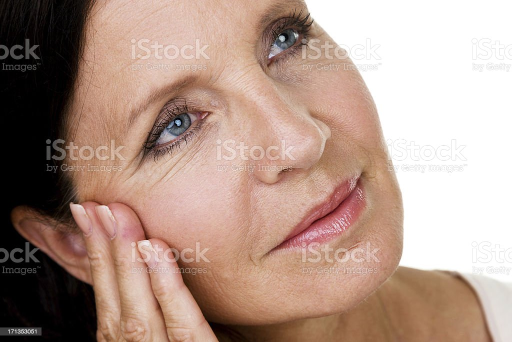 Mature woman day dreaming Closeup of a mature woman day dreaming 50-54 Years Stock Photo