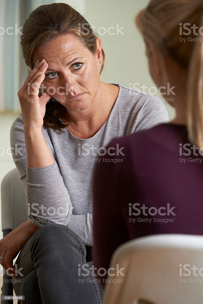 Mature Woman Discussing Problems With Counselor stock photo