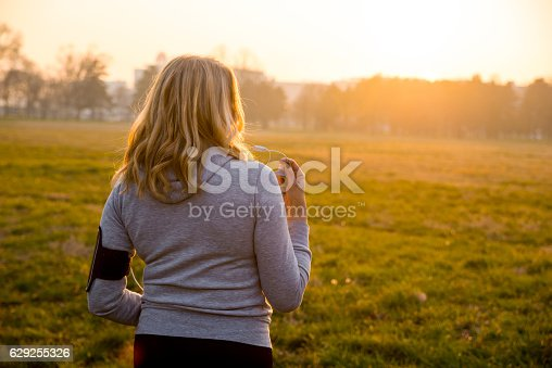 851958232istockphoto Mature woman doing Morning jogging in autumn park 629255326