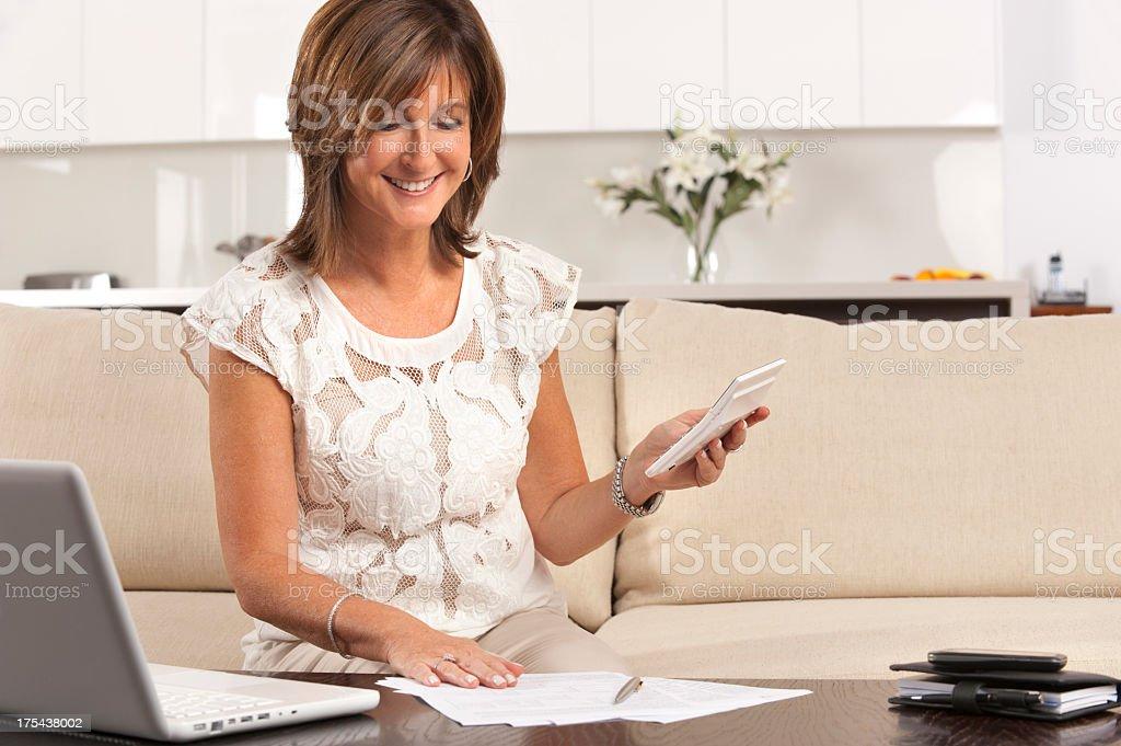 Mature woman doing paperwork royalty-free stock photo