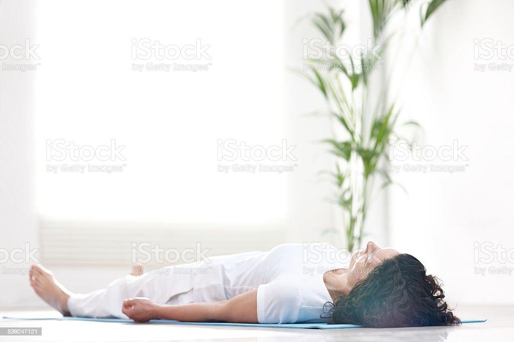 Mature woman doing savasana stock photo
