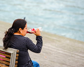 Mature Woman Drinking Coca-Cola