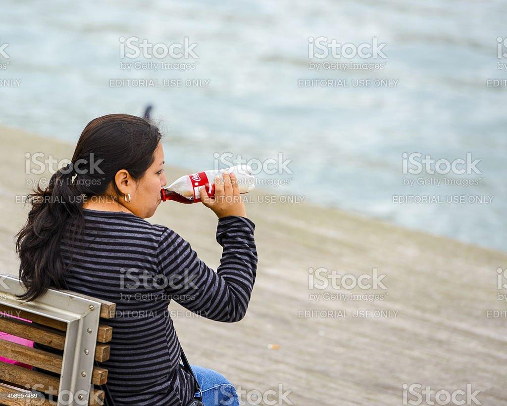 Mature Woman Drinking Coca-Cola stock photo