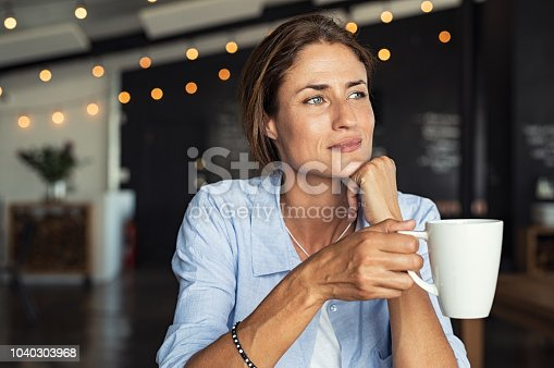 istock Mature woman drinking coffee 1040303968