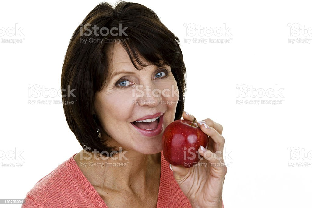 Mature woman eating healthy royalty-free stock photo