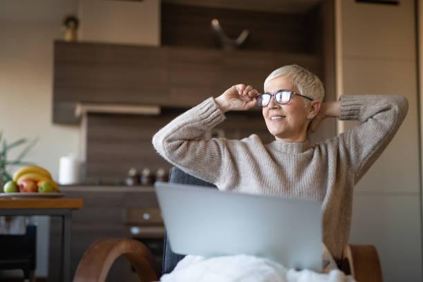 Mature woman enjoying her free time stock photo