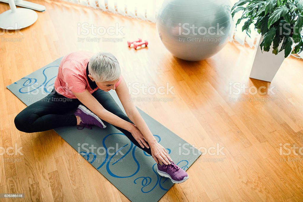 Mature Woman Exercise At Home. stock photo