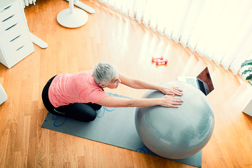 Mature Woman Exercise At Home Stock Photo - Download Image Now