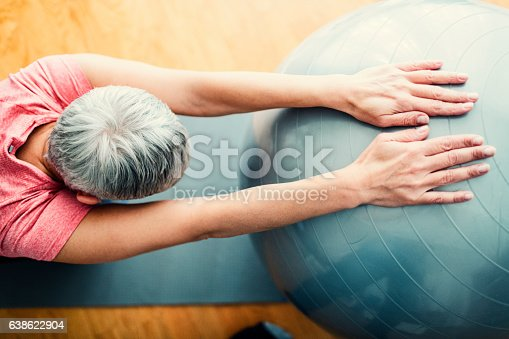 istock Mature Woman Exercise At Home. 638622904