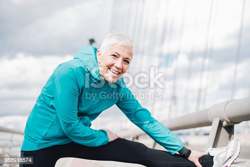 istock Mature woman exercising and smiling 958918574