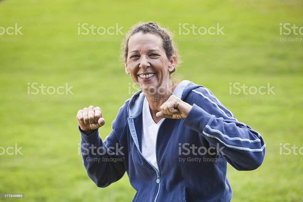 Mature woman exercising at the park stock photo