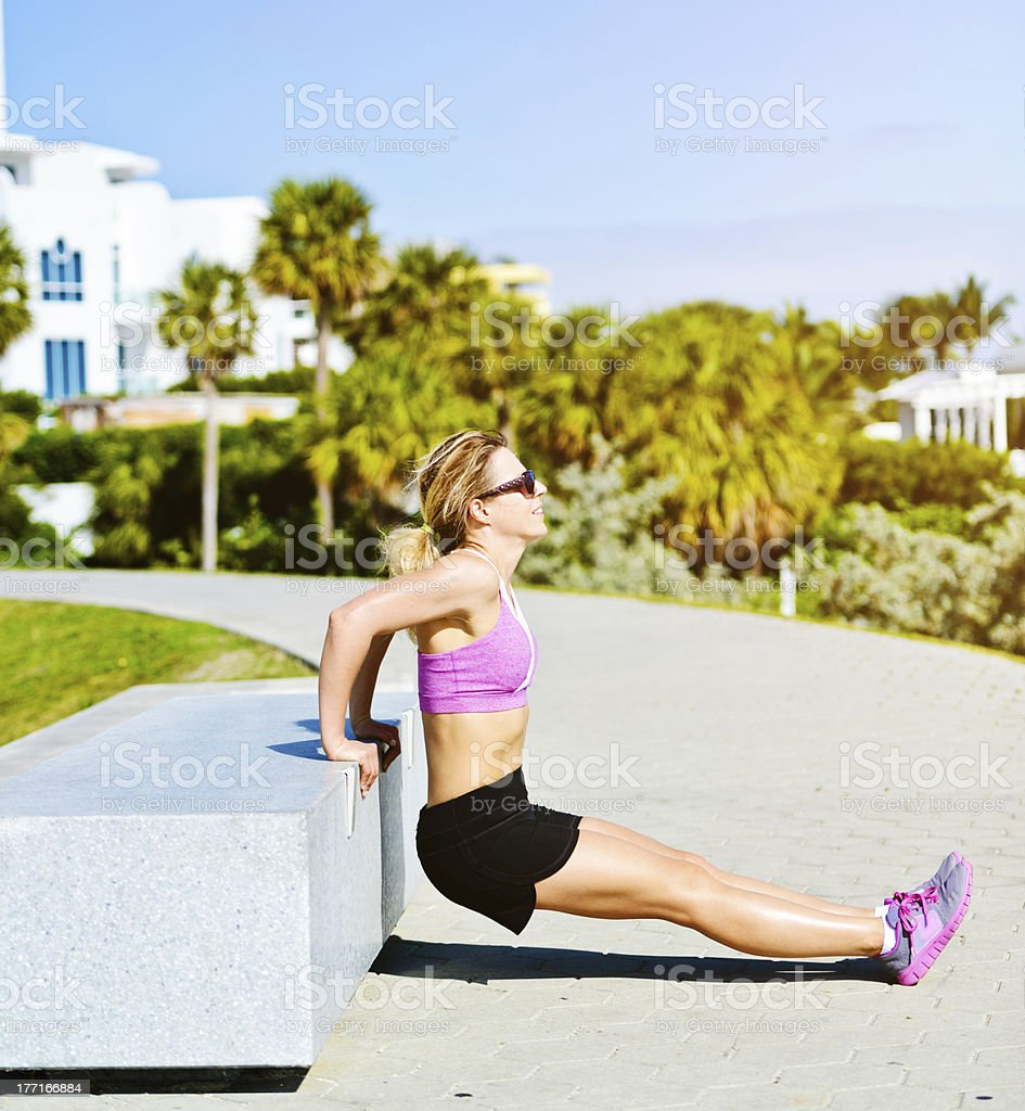 Mature woman exercising outdoors royalty-free stock photo